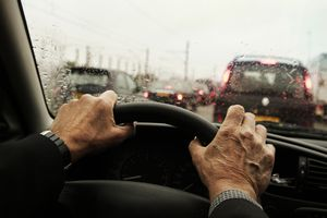 hands on steering wheel in traffic