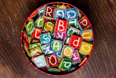 Bucket of colorful ceramic letter tiles