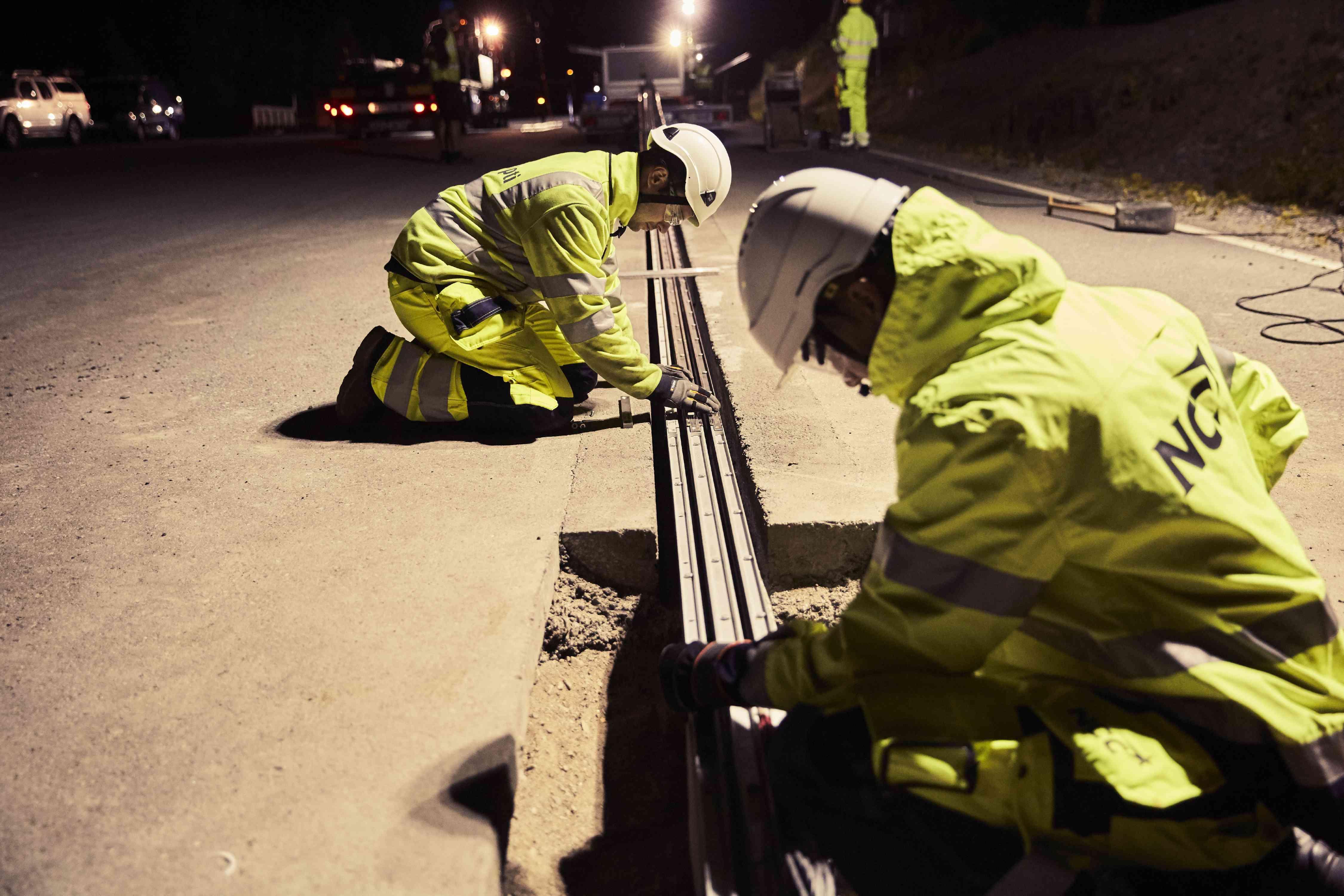 Installing electrified tracks at the eRoadArlanda near Stockholm.