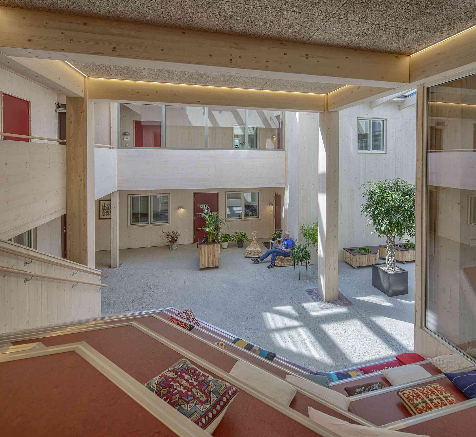 Vindmøllebakken Cohousing Project by Helen & Hard Architects courtyard entry interior