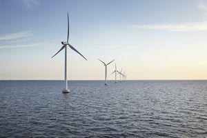 Row of wind turbines in the ocean