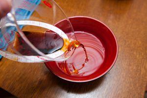 Pouring liquid into bowl.