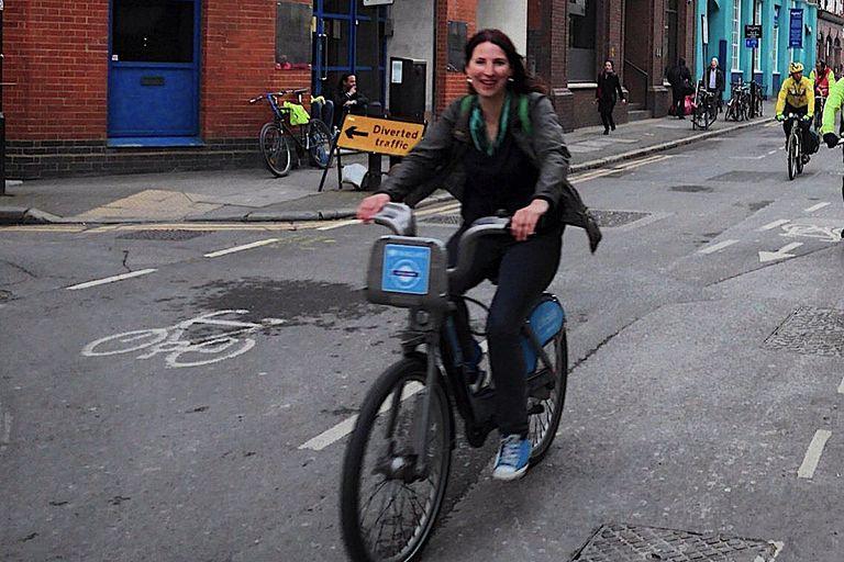 Rosalind Readhead on a bike in London