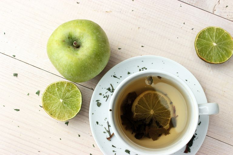 cup of green tea and an apple
