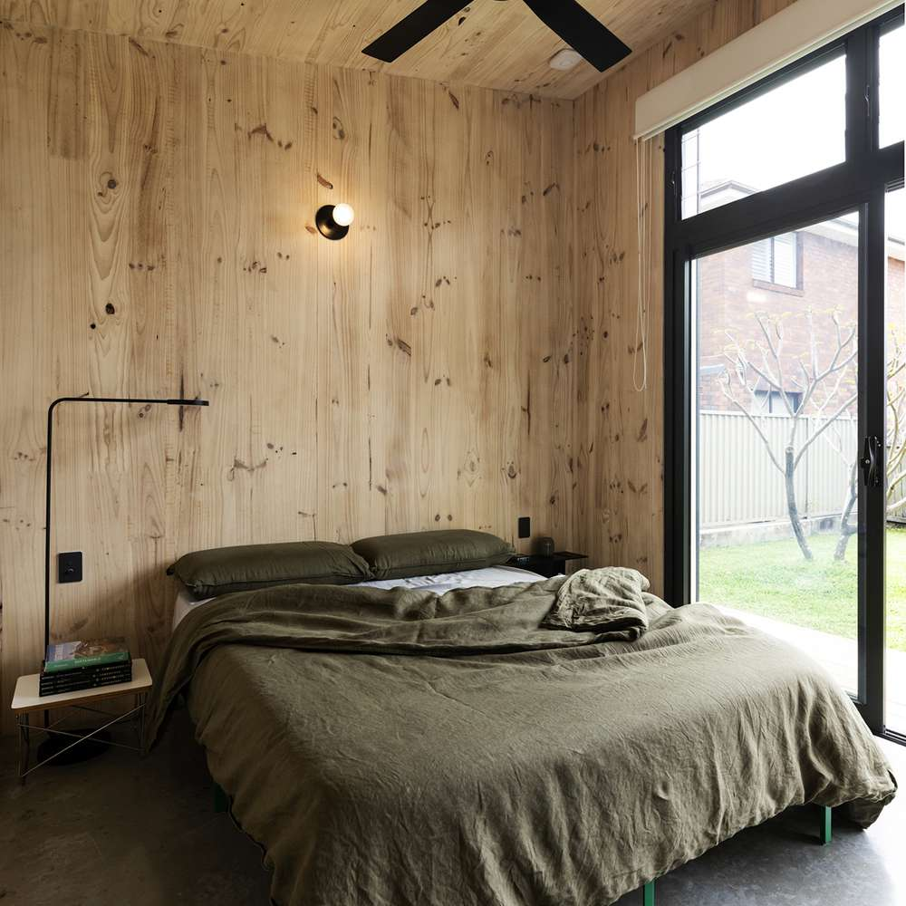 Sleeping area with bed and ceiling fan