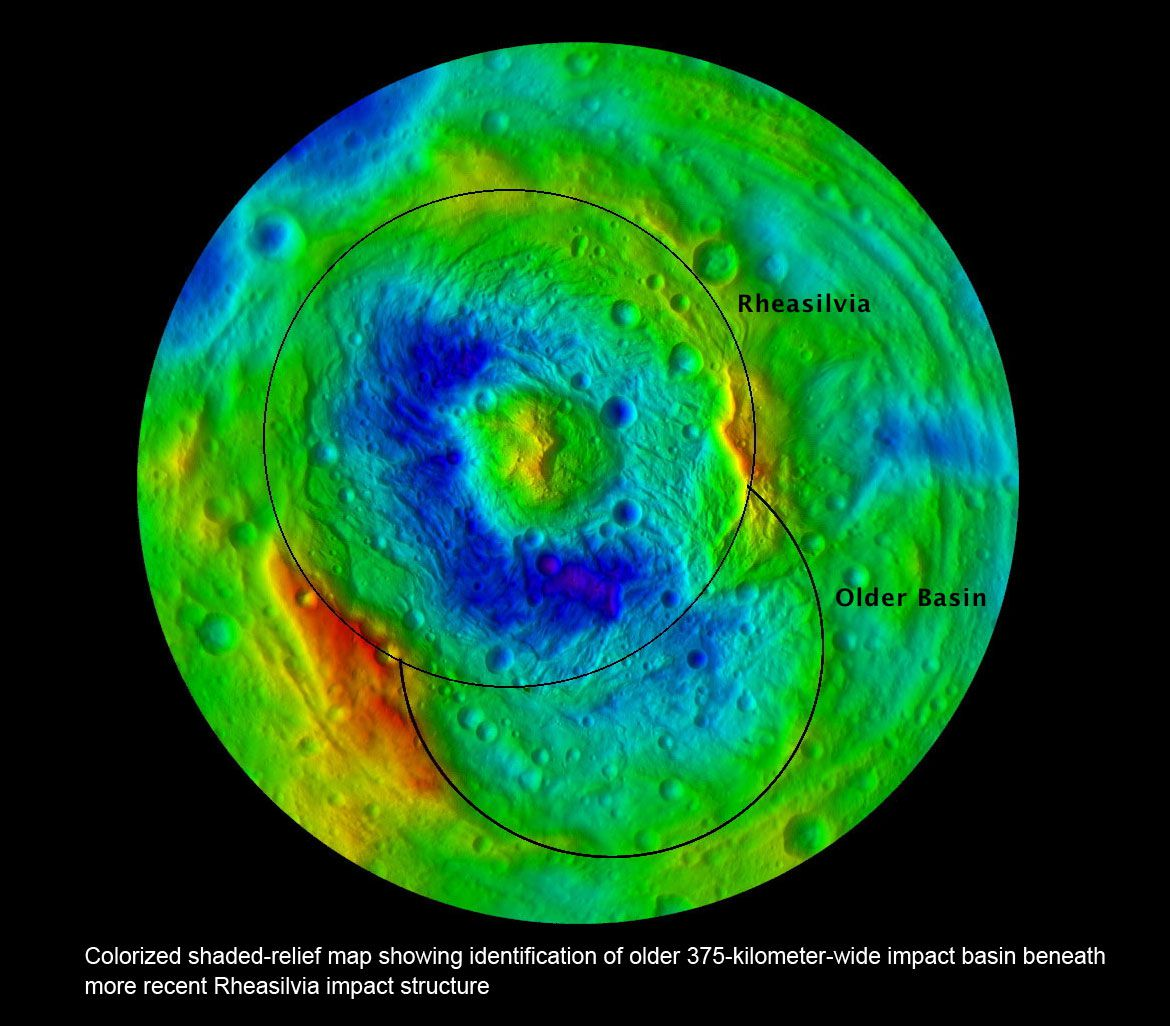 Vesta's 65,000-foot high peak rises from the center of the Rheasilvia impact crater. A much older crater, named Veneneia, was discovered underlying it.