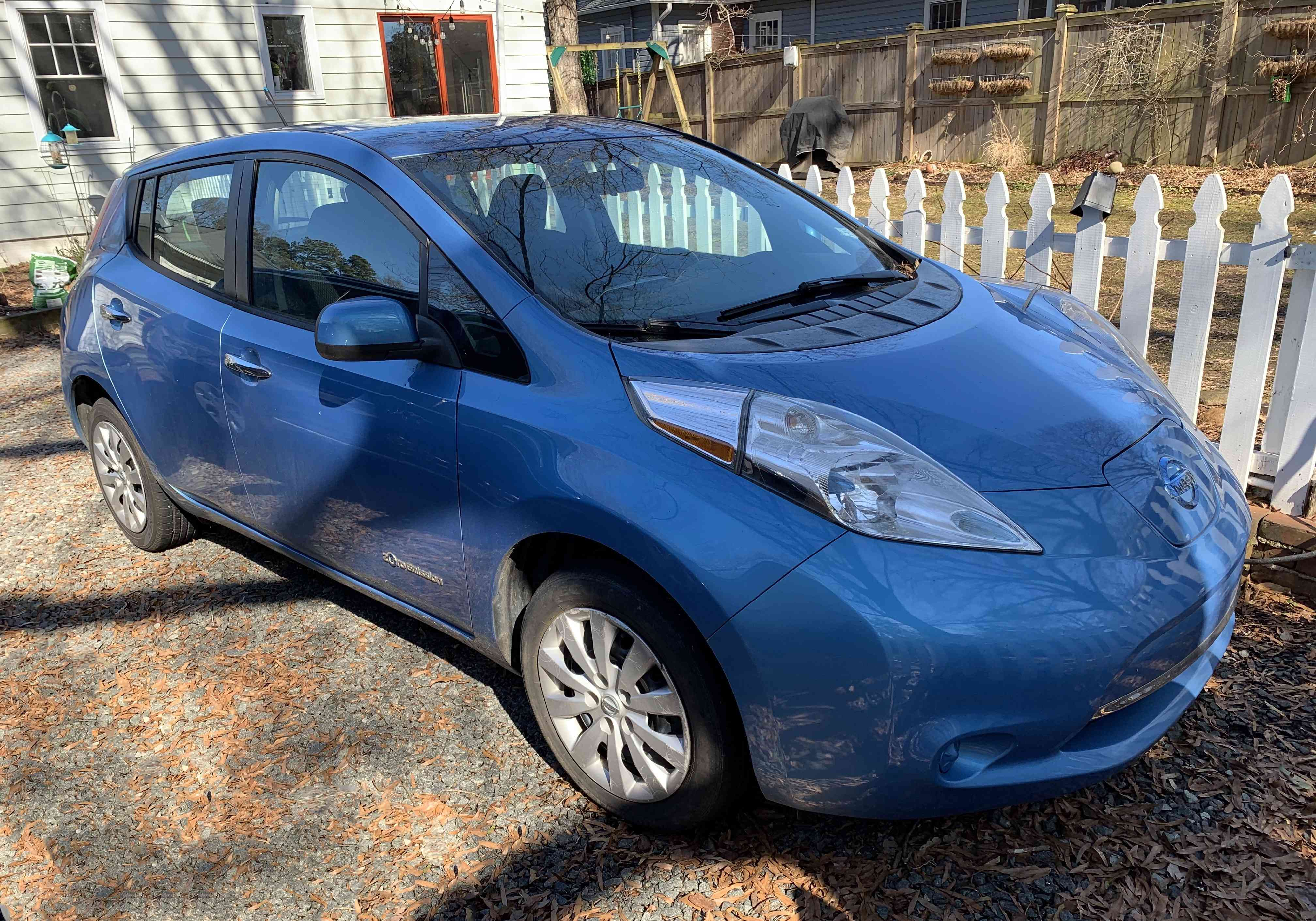 Blue Nissan Leaf in the driveway