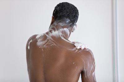 Washing body in shower