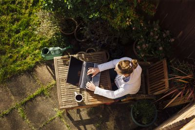 Woman working from home in her garden