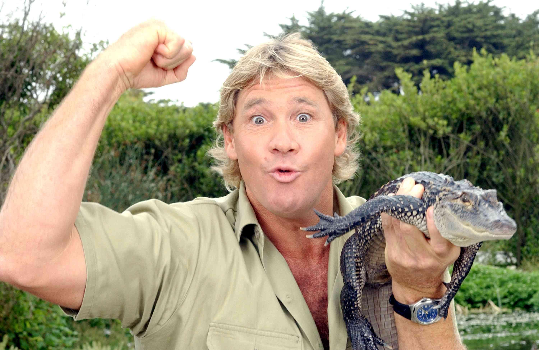 Steve Irwin holding crocodile with raised fist