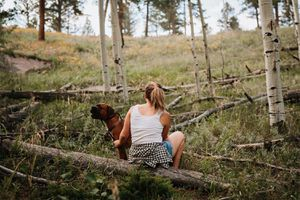 Woman and her dog in a forest