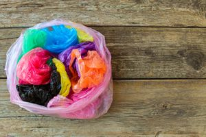 Multi-color plastic bags crumpled up.