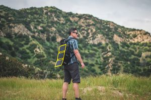 Man with Portable Solar Charger Panel
