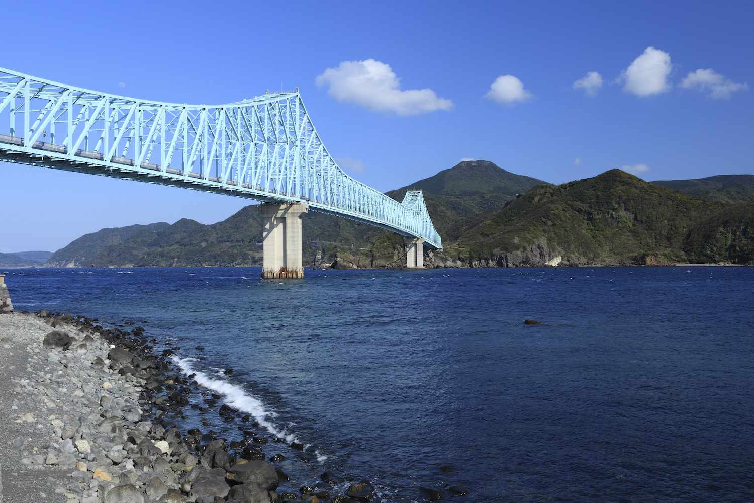 The pale-blue Ikitsuki Bridge in Japan on a bright afternoon