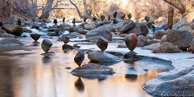 Single stone balanced on a creek