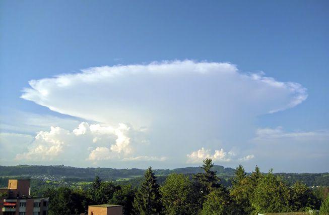 A large cumulonimbus cloud with an incus top