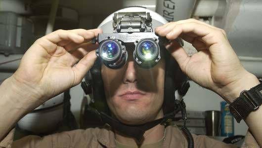 Lt. Chistopher London adjust AVS-9 night vision goggles
