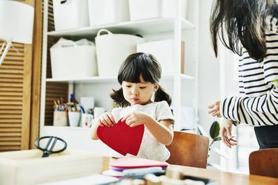 Young girl with paper hearts