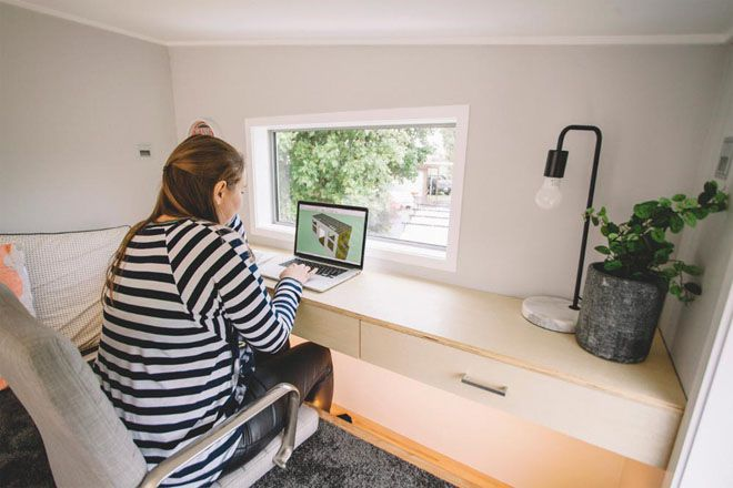 Woman sitting a desk in the work space loft