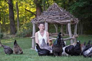 Kathy Shea Mormino in yard with chickens