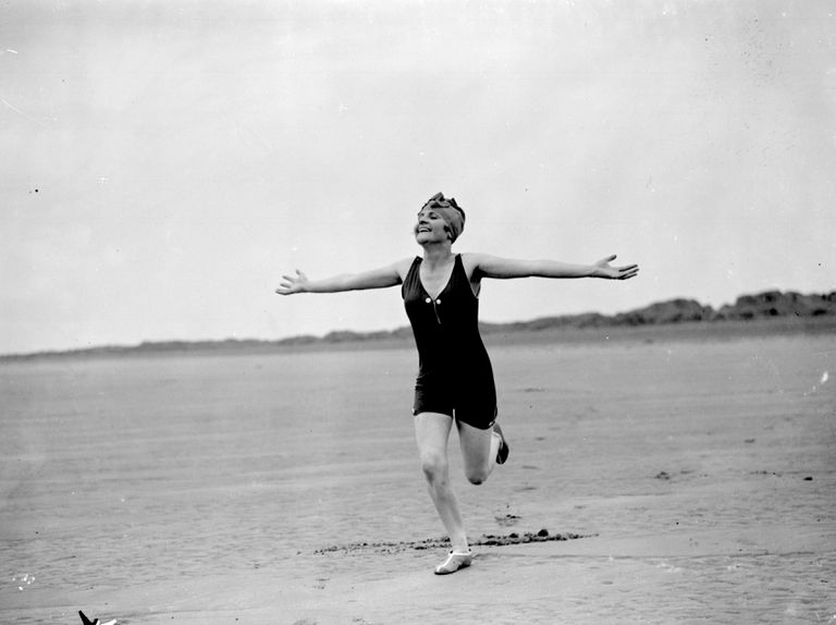 A swimmer runs with relish toward the Atlantic Ocean in Devon, England, in July 1926.