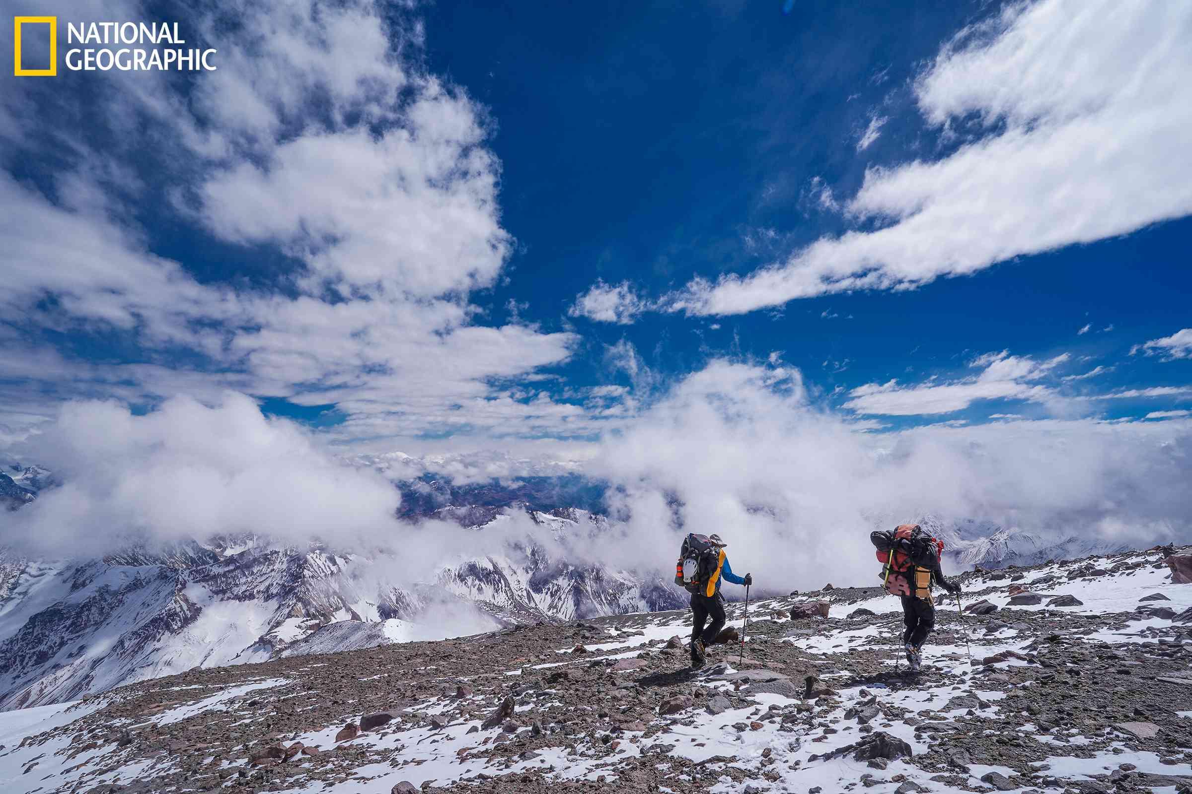 Perry and Gino Casassa, expedition team members, descend Tupungato Volcano