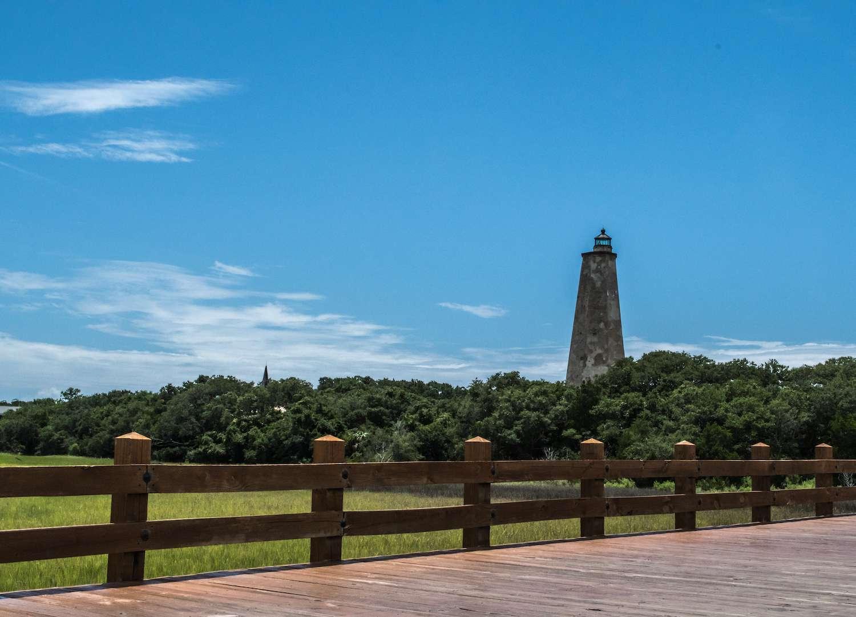A lighthouse on Bald Head Island on a sunny day