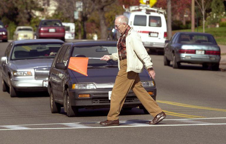 man carrying flag