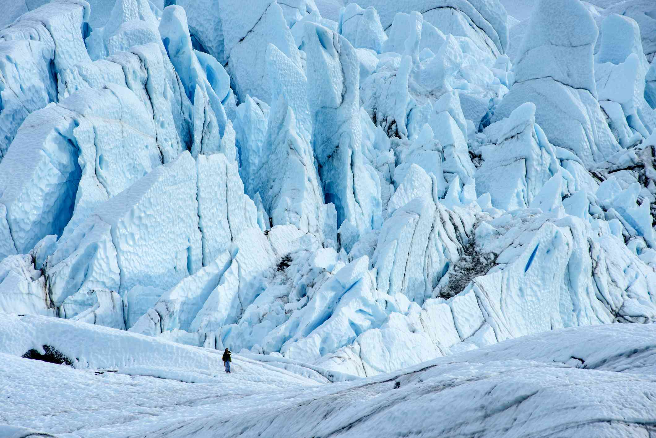 Person standing in the shadow of the Matanuska glacier