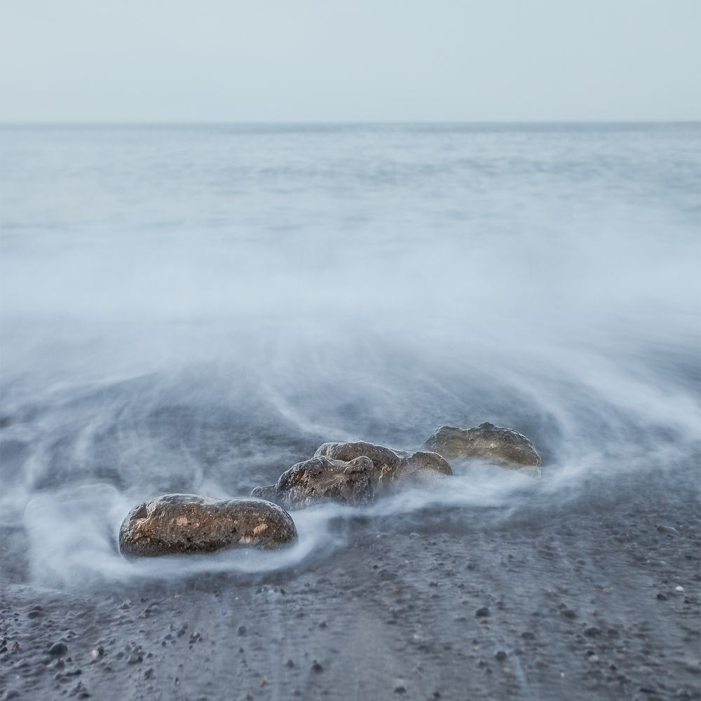 Waves turn into mist when using a slow shutter speed, which adds a little magic to your minimalist landscape.