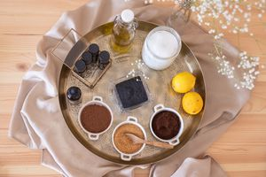 beauty shot of various zero waste beauty supplies on large metal tray