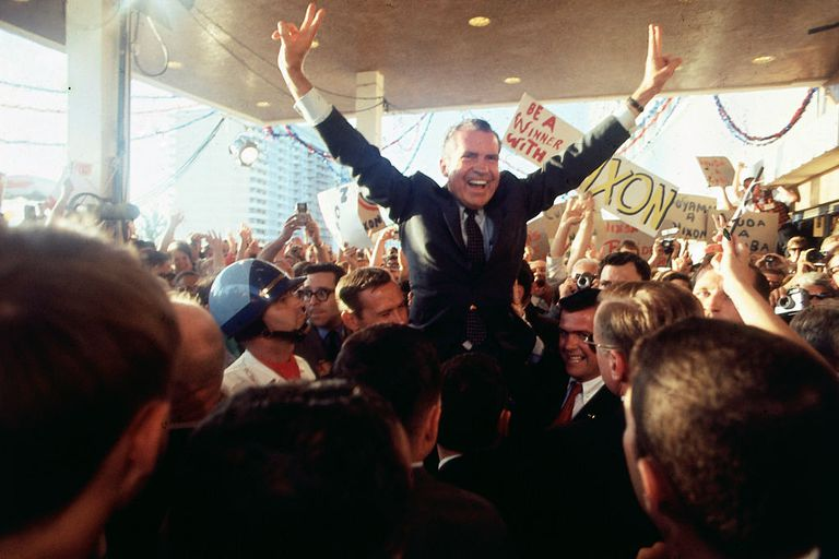 Richard Nixon celebrating with supporters of his