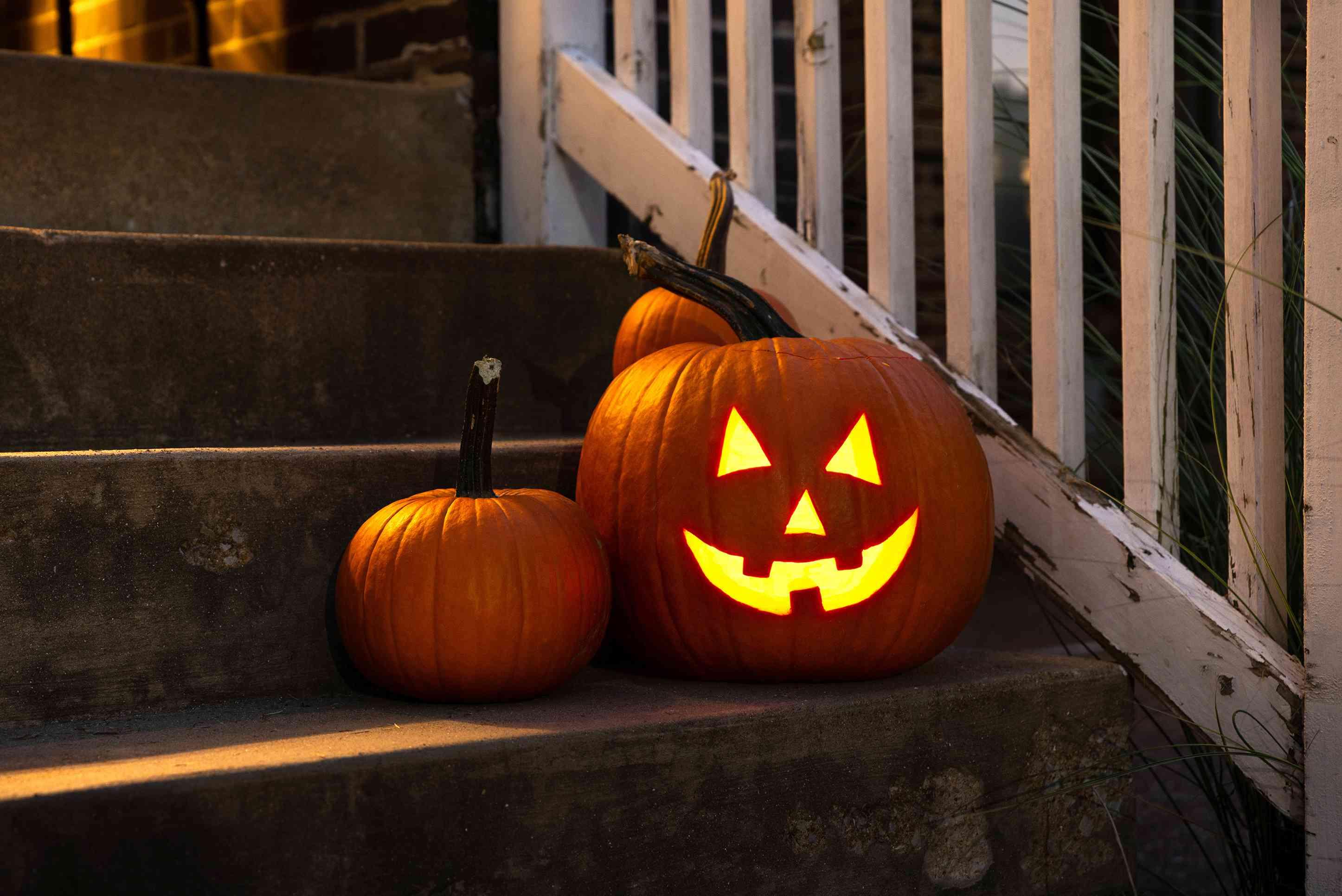 spooky glowing pumpkin at night