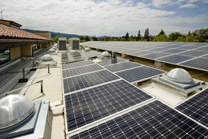 Solar panels on a roof with an HVAC system.