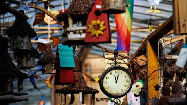 colorful bird cages at the Paris Bird Market
