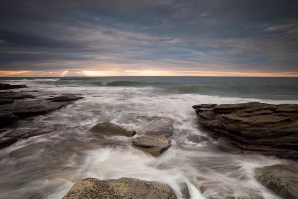Waves pound the rocks of a shoreline