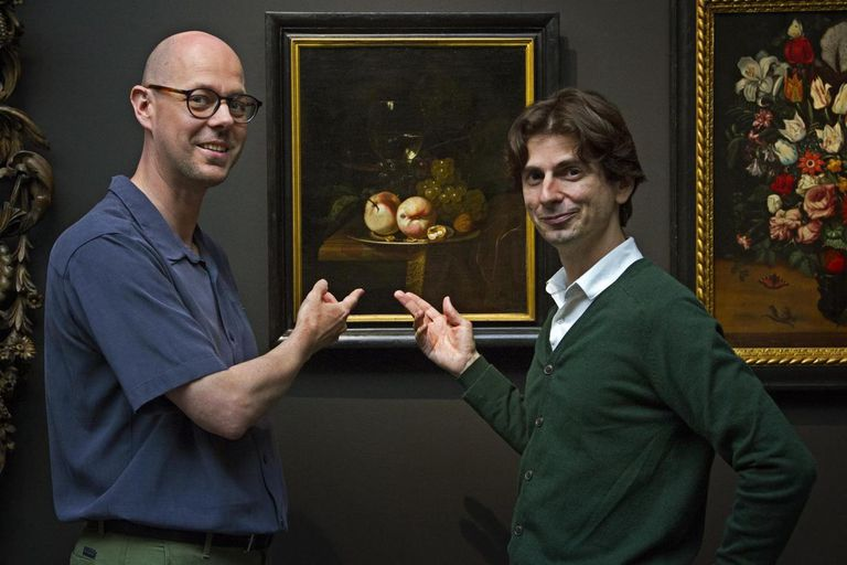 The study authors in front of a painting