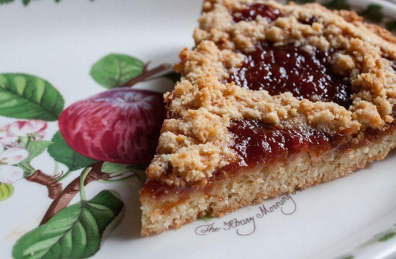 Slice of rhubarb and raspberry crostata