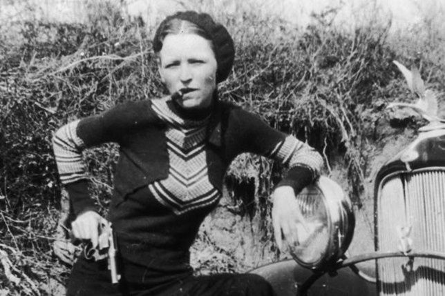 Bonnie Parker with stogie, gun and Ford