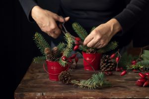 Making Christmas decoration from Rosehip, pine cones and fir branches