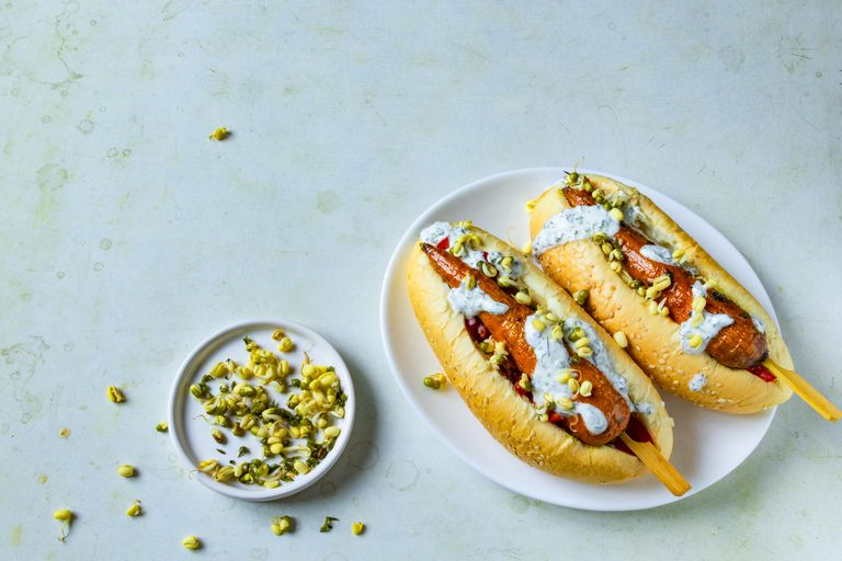 Hot dog with carrots on white plate. vegetarian fast food. Copy space