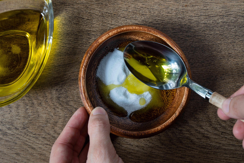 making olive oil salt scrub in bowl