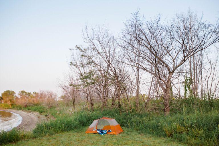 scenic view of orange tent on campsite