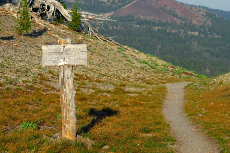 Wooden sign standing in a mountain landscape