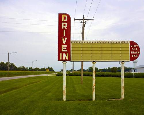 A sign for a drive-in movie