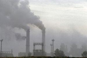 Smokestacks filling the air with smoke