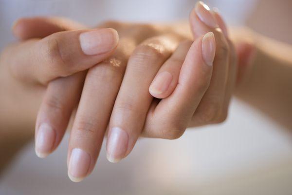 Close up of hands of Hispanic woman