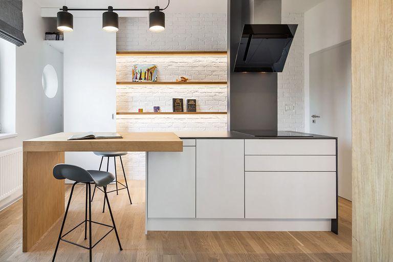 man's lair micro apartment boq architekti view of kitchen and dining