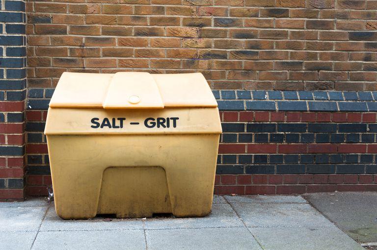 Salt bin against a brick wall.