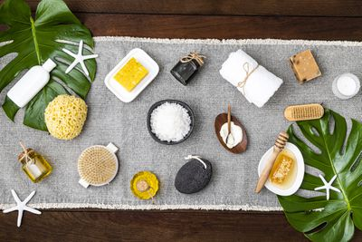 Bath products with copy space on a wooden background